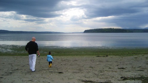 Brandy's husband and daughter at the beach