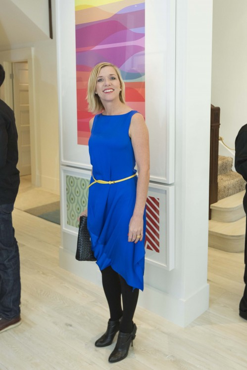 Lara Deam, founder of Dwell Magazine, in front of art selection curated by Marissa Mayer