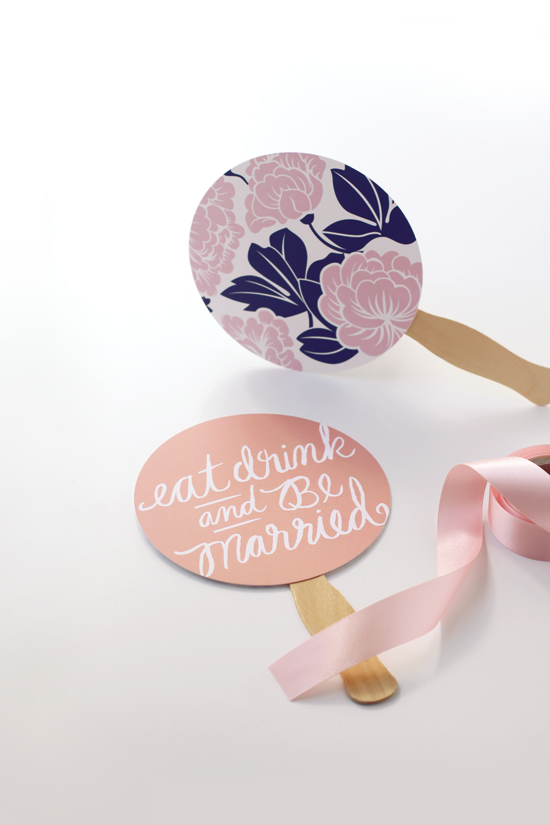 Minted table confetti repurposed as wedding hand fan favors