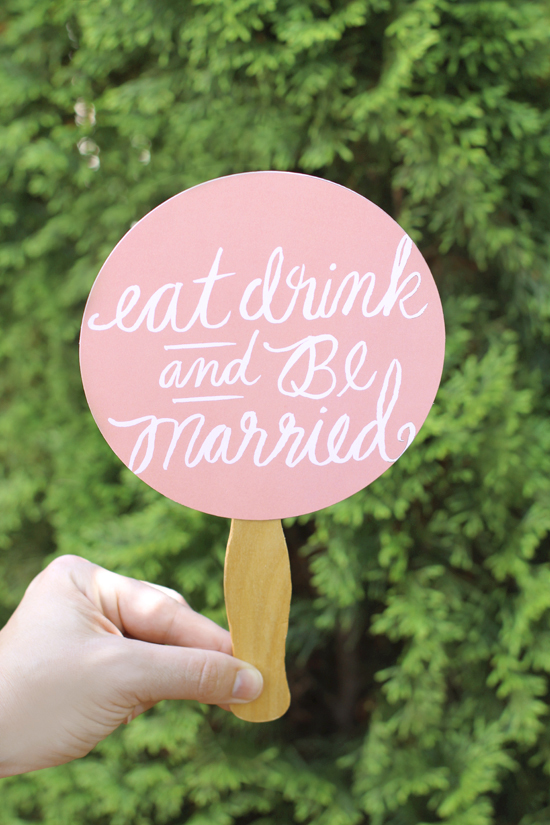 Simple wedding hand fan created from Minted table confetti decor