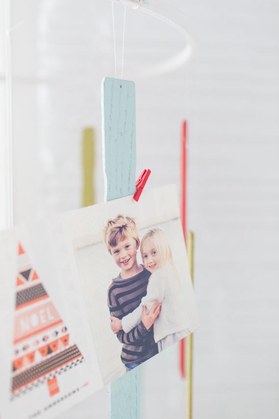 DIY paint stirrer holiday card mobile