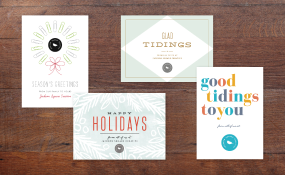 the minimalist design lets the photo and company logo take center stage and the transparent angled overlays lend subtle style - Corporate Holiday Cards