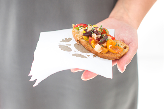 tomato crostini on sticker embellished cocktail napkin