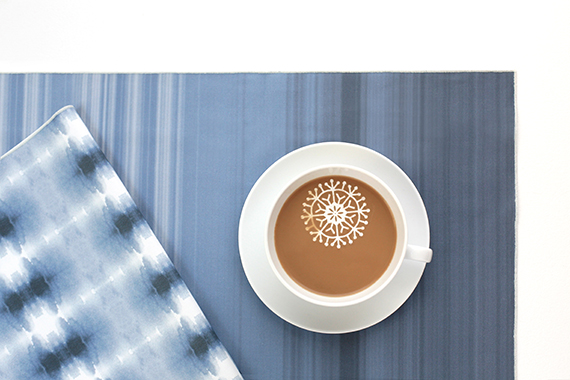 blue holiday linens and sugar snowflake in coffee