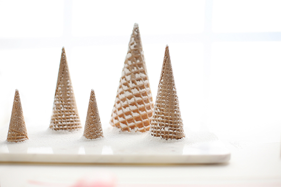 sugar-dusted raw ice cream cones as christmas trees for an edible centerpiece.