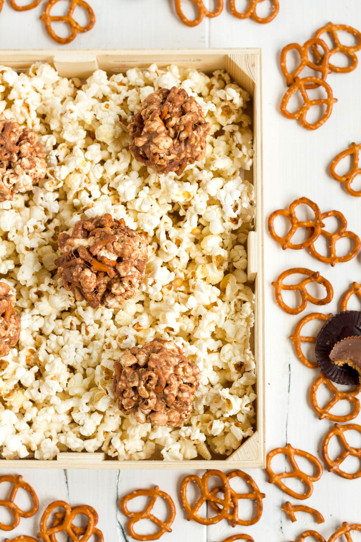 These yummy peanut butter pretzel popcorn balls will be irresistible to kids and adults alike!