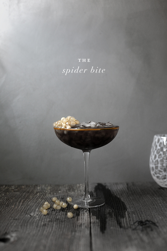halloween horror inspired cocktails by kelli hall: Spider bite black russian with tapioca pearl spider sac garnish