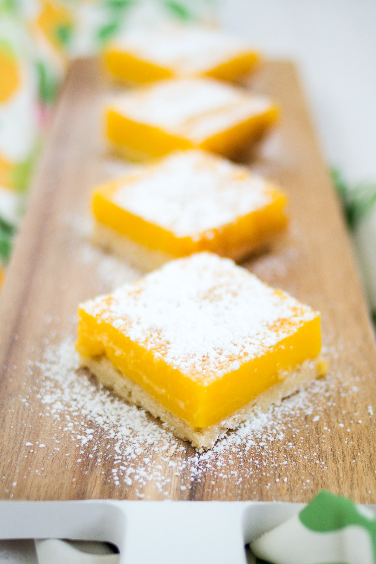 These delicious citrus bars have a tart and tangy layer of homemade lime curd atop a buttery shortbread crust.
